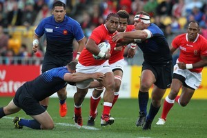 Taniela Moa surges into the French defences yesterday. Photo / Paul Estcourt