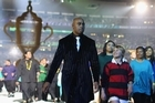 Former All Black star Jonah Lomu and Ethan Bai in front of the Webb Ellis Cup during the IRB 2011 Rugby World Cup Opening Ceremony at Eden Park on September 9. Photo / Getty