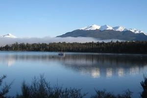 The Earl Mountains are reflected in Mirror Lakes on the picturesque Milford Rd. Photo / Justine McLeary