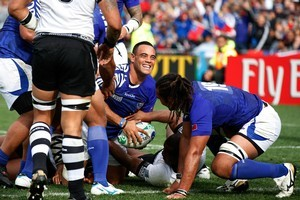 Samoa's halfback Kahn Fotuali'i after scoring. Photo / Brett Phibbs