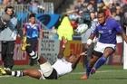 Fiji's Kini Murimurivalu passes off the ground away from Samoan defence. Photo / Paul Estcourt