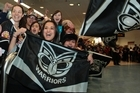 A large crowd welcomes home the Warriors at Auckland Airport after their victory in Melbourne. Photo / Richard Robinson