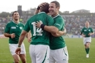 Paddy Wallace, right, congratulates Fergus McFadden for scoring the first try. Photo / APN
