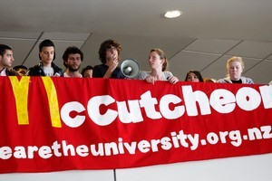 Auckland University students protest and occupy level six of the Owen G Glenn Building with a banner mocking Vice Chancellor Stuart McCutcheon. Photo / NZ Herald