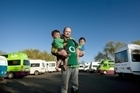 Rugby World Cup campervan fans Declan Murphy with twins Oisin and Saoirse (19-months-old). Campervans parked at the lakefront have upset local campground owners. Photo: Stephen Parker