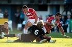 Japan's Sione Talikavili Vatuvei is tackled by  Canada's Adam Kleeberger. Photo / Richard Robinson
