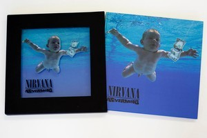 Nirvana's super deluxe version comes with book, posters, four CDs and a DVD. Photo / Steven McNicholl