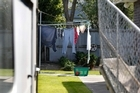 The yard of the Kaiapoi house where the couple died. Photo / Martin Hunter