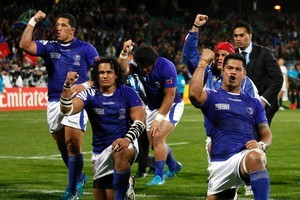 The Samoans thank their supporters after the loss to the Springboks. Photo / Dean Purcell