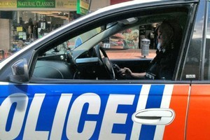 A fellow motorist snapped the policeman allegedly texting while driving. Photo / Supplied