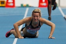 Nikki Hamblin fell in her 1500m heat at the world's. Photo / Getty Images