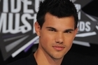 Taylor Lautner would like to follow in the footsteps of his screen heroes Matt Damon and Harrison Ford. Photo / AP