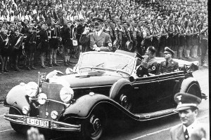 Hitler leaving Nuremberg Stadium, after taking part in the Hitler Youth Demonstration. A ticket from 1931 has found he was caught speeding - at 55kph. Photo / supplied