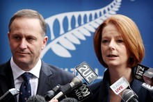John Key and Julia Gillard have a little competition over which of their rugby league teams will win the NRL grand final. Photo / Greg Bowker