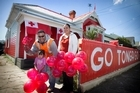 Tevita, Fane and Mary Lou, 3, Lisiate outside their Burnley Tce home. Photo / Natalie Slade