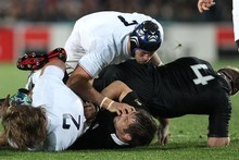 Richie McCaw receives a hand in the face from France's Julien Bonnaire. Photo / NZ Herald