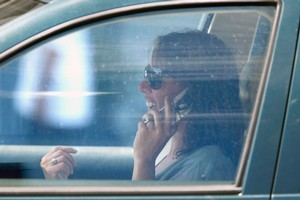 Using hand-held cellphones while driving is banned. Photo / Steven McNicholl