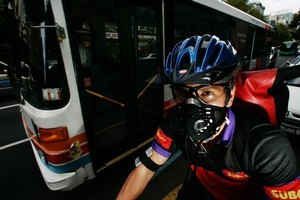 Courier Mike West wears a mask   because of  the pollution in  Queen St. Photo / Chris Skelton