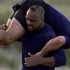 All Black Jonah Lomu carries then coaching co-ordinator Robbie Deans. Photo / Getty Images