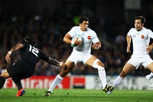 Maxime Mermoz of France steps away from Ma'a Nonu of the All Blacks. Photo / Getty Images