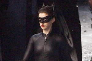 Anne Hathaway shows off her Catwoman suit on the set of The Dark Knight Rises.