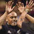Doug Howlett and Jonah Lomu celebrate a try with Tana Umaga in Wales, 2002. Photo / Getty Images