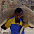 This photo of a man carrying a shark through the streets of Mogadishu, Somalia, won the Daily Life Award. Photo / Feisal Omar/Reuters