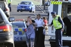 A woman is helped to a waiting ambulance after last year's attack. Photo / Otago Daily Times
