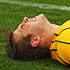 Drew Mitchell of the Wallabies lies on the ground injured. Photo / Getty Images