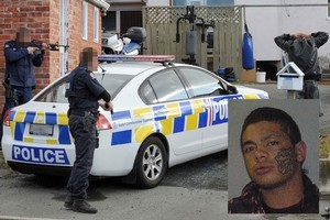 Police arrested 10 people yesterday after a gang shooting in Dunedin yesterday, but are still hunting 19-year-old Dylan Hill. Photo / Otago Daily Times
