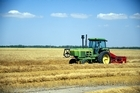 To relieve farmers from a bit of the tough slog, Kinze are working hard to develop an 'intelligent' driverless tractor and grain cart. Photo / Thinkstock
