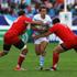 Santiago Fernandez of Argentina is tackled by Giorgi Chkhaidze (L) and Vasil Kakovin of Georgia. Photo / Getty Images