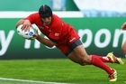 Lasha Khmaladze of Georgia goes over to score his try. Photo / Getty Images