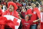 Delerious Tongan fans celebrate the win over France. Photo / Paul Estcourt