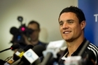 Dan Carter speaks at a press conference today about his having to pull out from the rest of the Rugby World Cup due to a serious groin injury. Photo / Natalie Slade
