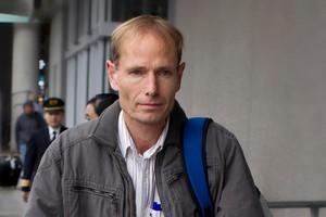Dr Sean Davison arriving at Christchurch airport ahead of his trial. Photo / Martin Hunter