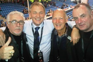 Sir Peter Leitch, Phil Goff, unknown and Trevor Mallard grab a photo at the Silver Ferns' game against England. Photo / Supplied