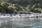 Hundreds of boats line the beach at Lake Tarawera before the opening of the trout-fishing season. Photo / Geoff Thomas