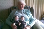 Betty Batchelor and the All Black dolls she knitted. Photo / Supplied