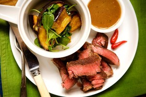 Beef with tamarind, fried eggplant and spinach salad. Photo / Babiche Martens