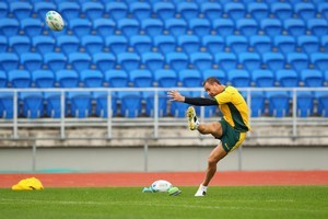 Quade Cooper and the other Wallaby boots have been sending video of their practsing to coach Braam van Straaten using a video-sharing website, his instructions coming back to them online via Skype. Photo / Getty Images