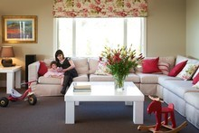 Florals and vintage prints are used in blinds and cushions for cohesion. Photo / Your Home & Garden