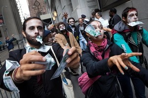 Protesters from Occupy Wall Street march through New York's financial district dressed as corporate zombies. Photo / AP