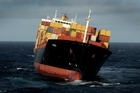 The container ship Rena is still 'totally salvagable', according to a salvage expert. Photo / Alan Gibson