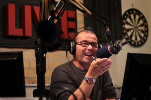 Paul Henry at work in the studio, hosting the 'Drive' programme at Radio Live. Photo / Janna Dixon