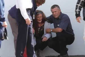 Grey District mayor Tony Kokshoorn offers support to a distraught family member of the 29 miners trapped in the Pike River coal mine last year. Photo / Mark Mitchell
