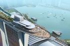 The Marina Bay Sands resort includes a hotel made up of three 55-storey towers, topped off with what looks like a curved ocean liner full of gardens, restaurants and pools. Photo / Supplied