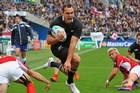 All Black Israel Dagg leaps through the challenge from Matt Evans of Canada to score. Photo / Getty Images