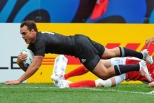 Wing Israel Dagg dives over to score the All Blacks' third try in their Rugby World Cup clash against Canada. Photo