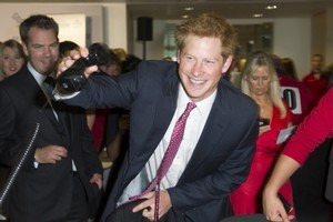 Princes William and Harry feature with their parents in the footage. Photo / AP